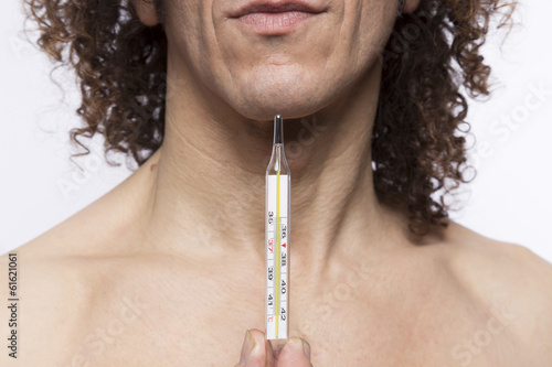 Man holding thermometer