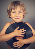 boy with a record smiles poster