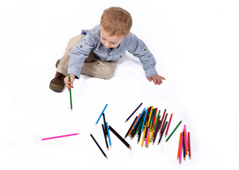 baby draws with crayons