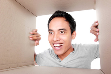 man looking for something inside box