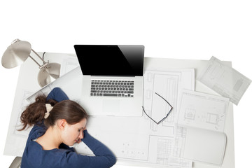 portrait from high point of woman sleeping behind desk