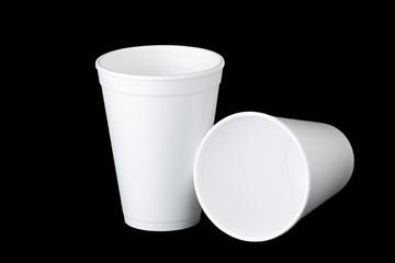 two styrofoam cups on black