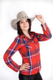 Girl cowboy hat and plaid shirt, cute smiling
