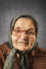 Portrait of an old woman on a vintage background.