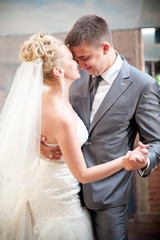 Closeup portrait of bride and groom dancing waltz
