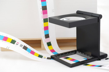 CMYK printing color bar and loupe.