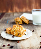 Homemade oatmeal cookies with nuts and raisins and milk