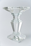 Glass candlestick on gray background