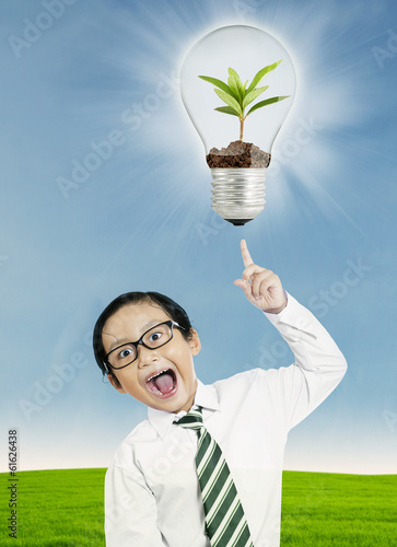 Boy pointing at light bulb