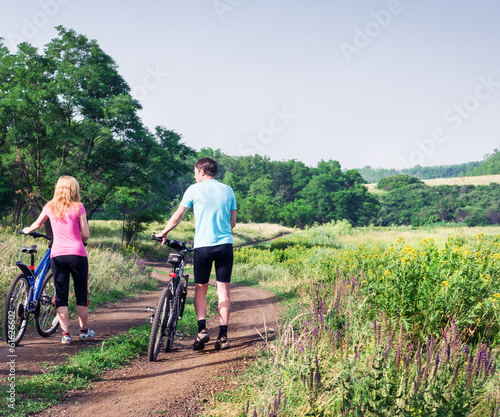 a couple relax biking outdoors