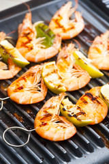prawn skewers with lime on electric grill