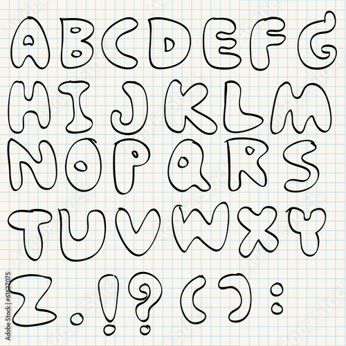Hand drawn alphabet on line paper