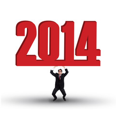 Businessman is lifting new year 2014 isolated