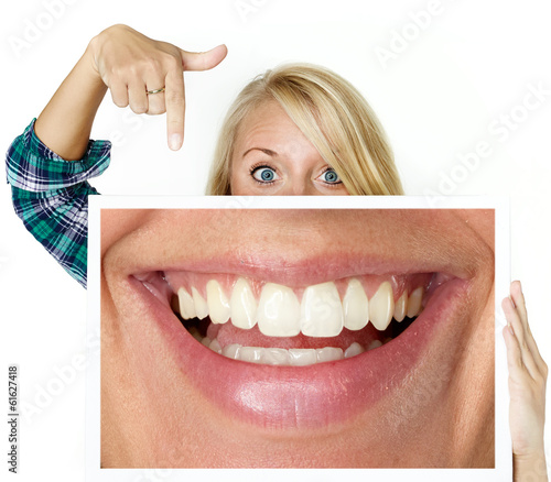 Woman shows picture with a big smile