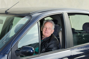Old man in car