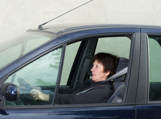 Scared woman in car