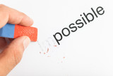 Motivational concept: word impossible turning into possible