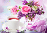 Spring flowers and cup of tea