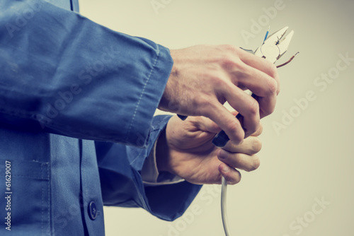 Workman repairing an electric cable