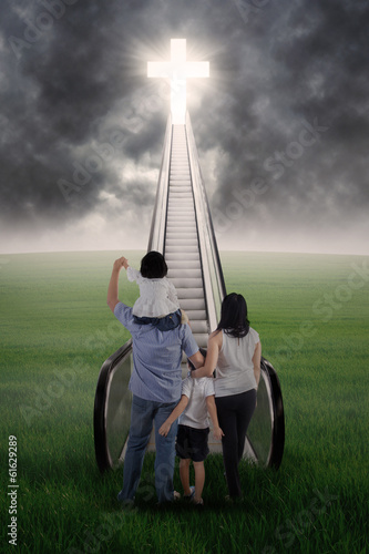 Christian family on the stairs
