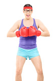 Excited young man posing with boxing gloves