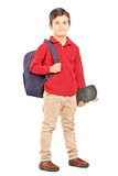 Male kid with backpack and skateboard