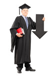 Mature man in graduation gown holding big arrow pointing down