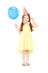 Cute little girl with party hat holding balloon