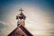 Rural old church steeple cross and bell tower - 61630254