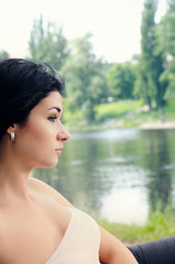 Sophisticated young woman overlooking a lake