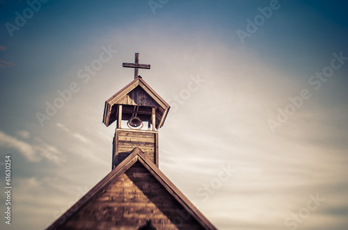 Fotobehang Bedehuis Rural old church steeple cross and bell tower