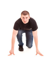 young man ready to run, white background