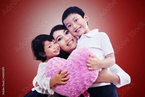 Happy family together on red