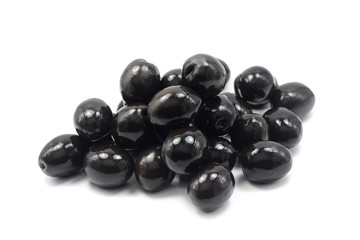 a handful of black olives on white background
