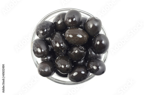 black olives in a glass cup on white background