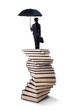 Woman standing on a stack of books