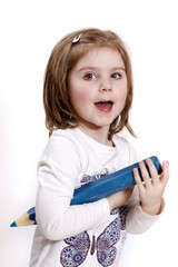 Little girl holding big blue crayon