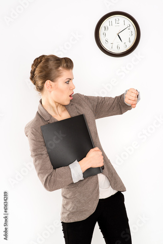Rush time. Stressed woman looking at her watch in hurry