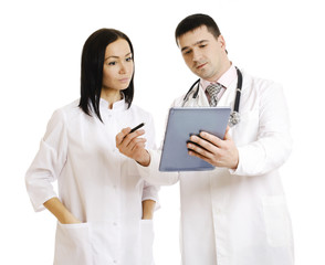 Successful doctors using together a touchpad. - Stock Image