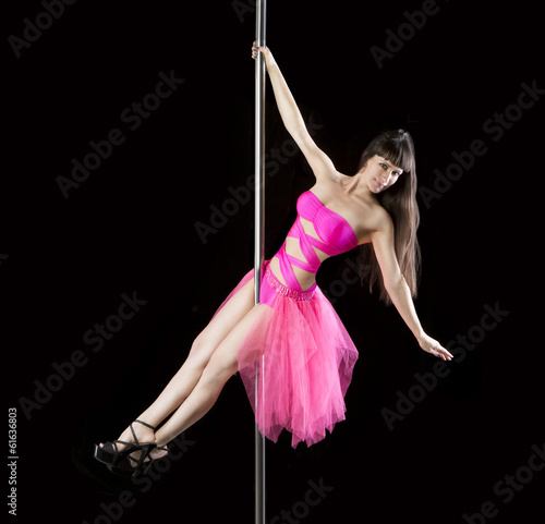Poledancer in bright pink dress