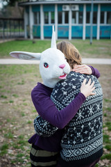 young hipster cuople lovers rabbit mask