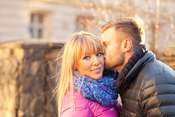 Young man kissing a beautiful woman