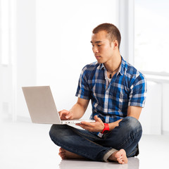 Young Asian man surfing the net