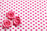 polka dot paper and pink decorative roses