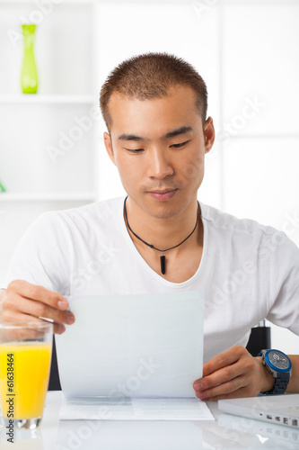Young Asian male working at home
