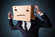 Businessman gesturing with a cardboard box on his head with stra