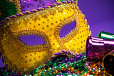 Mardi Gras or Carnivale mask on a purple background