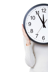 Woman holding a clock isolated on a white background