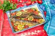 Fish. Roasted mackerel and tomatoes with garlic, basil and lemon