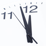 Close up of a clock face showing the hands at two minutes to 12